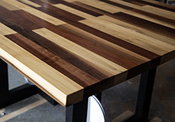 Contemporary square table made with many types of wood