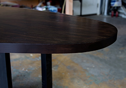 Custom narrow oval shape table with black walnut stain