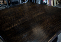 Square black walnut stained dining table