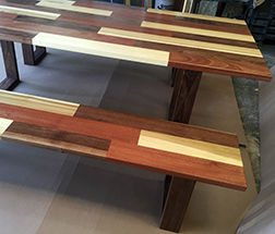 Modern dining table with matching set of seating benches