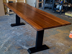 Mahogany dining table with natural edge