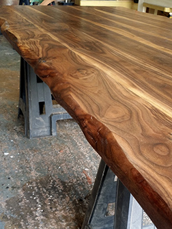 Detail of the natural edge of the walnut table top