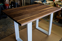 Counter height walnut table with white base