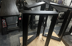 Three black stained tables getting ready to ship
