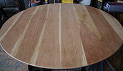 Round unfinished cherry table top with bevel edge