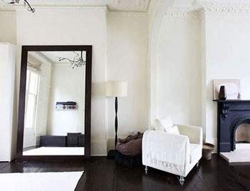 Decorative floor mirror in living room