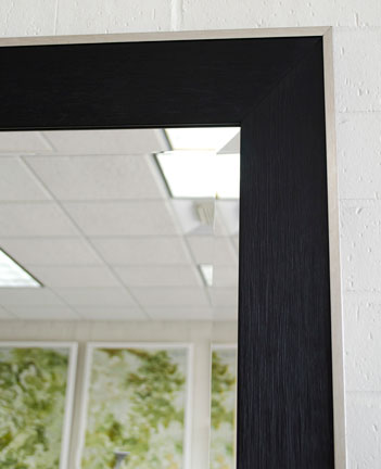 Simple black framed mirror with silver lip