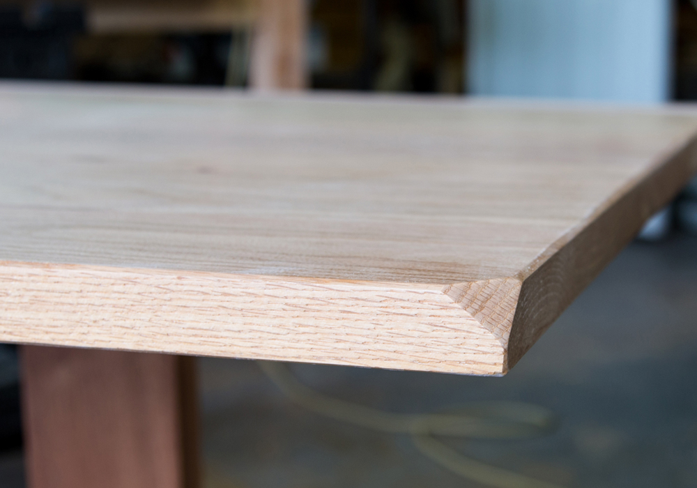 Aurora Bevel Cut At The Corners On A Red Oak Table Top