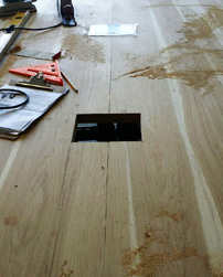 Hudson Table - Custom grommet cuts on two hickory table tops that will be placed next to each other in a conference room