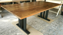 Florence Table - Rustic alder table top with 3 column trestle base in black finish