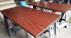 Bandera Table - Two mahogany table tops with custom grommet cut for a hotel office
