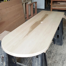 Sedona Table - Custom half-oval maple table top with grommet cut in center going in a conference room