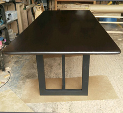 Burke Table - Bronze walnut finish table top with bullnose edges on black base