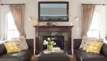 Framed mirror over fireplace
